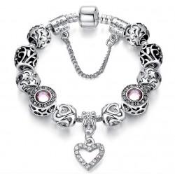 Pulsera con charms plateados y cristal rosa y corazón