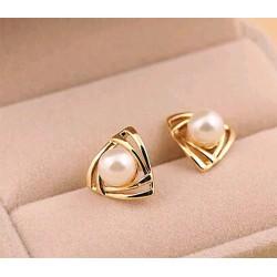 Pendientes dorados con perla