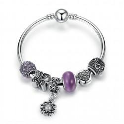 Pulsera rígida con charms cristales color violeta y colgante flor