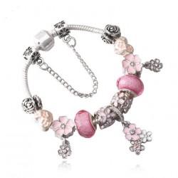 Pulsera con abalorios de cristal rosa y colgantes flores