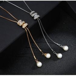 Collar largo con 2 colgantes con perla