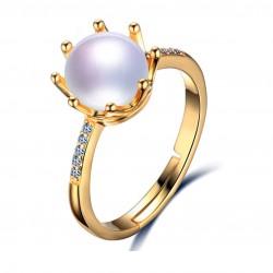 Precioso anillo con corona y perla natural