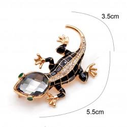 Broche en forma de salamandra con ojos verdes
