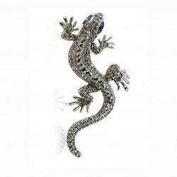 Broche en forma de lagarto con ojos azules