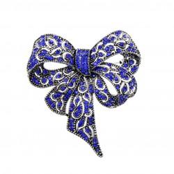 Broche en forma de lazo con cristales azules